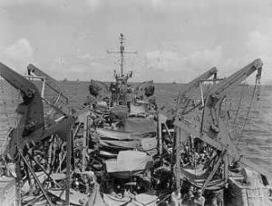 LST-695 en route to the Philippines on October 22, 1944. The surviving sailors rigged these rough awnings to shield them from the tropical sun.